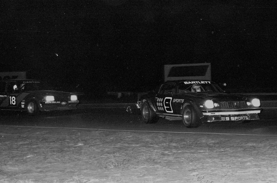 Kevin Bartlett's Camaro leading Murray Carter's Falcon