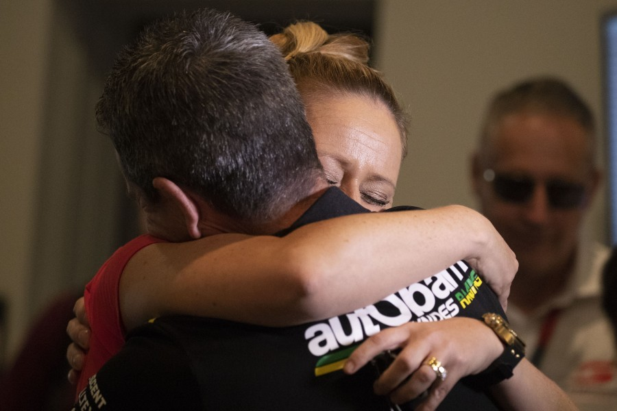 Lowndes embraces wife Lara after the press conference