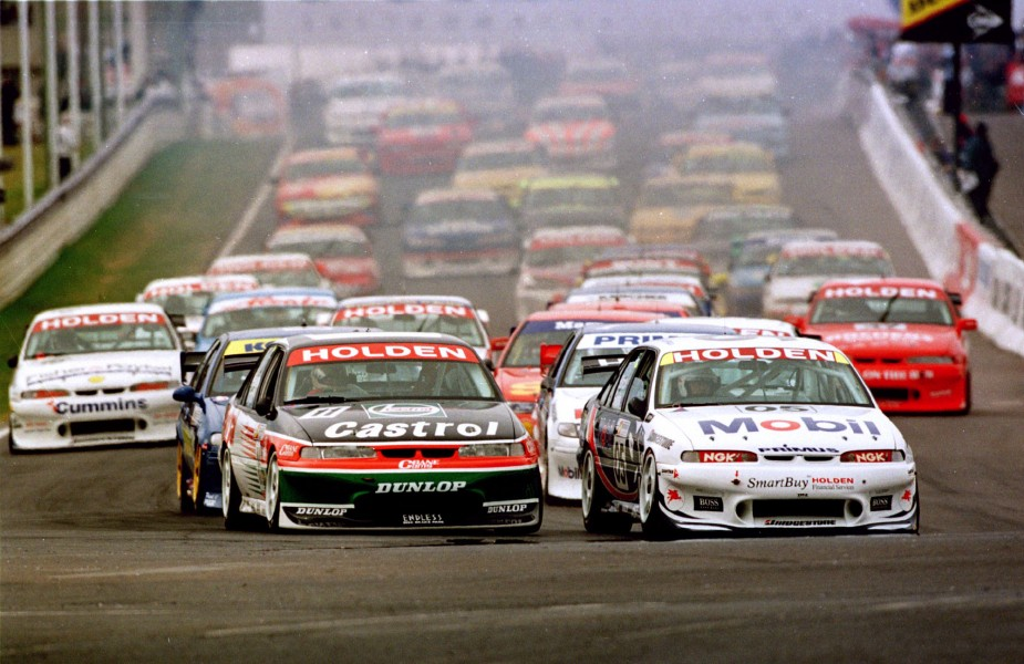 Bat01:SPORT-MOTOR:BATHURST,AUSTRALIA,19OCT97 - Peter Brock driving the 05 Modil Commodore leads the field into the first corner of the Primus 1000 Clasic at Mt Panorama Bathhurst.Pic By Mark Horsburgh
