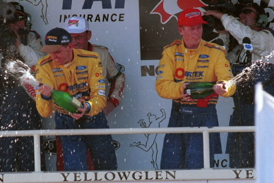 BATHURST AUSTRALIA 15/11/98: Australian drivers Jason Bright(left) and team mate Steven Richards celebrate after driving there Pirtek Ford Falcon to victory during the FAI 1000 at Bathurst today. Pic Mark Horsburgh