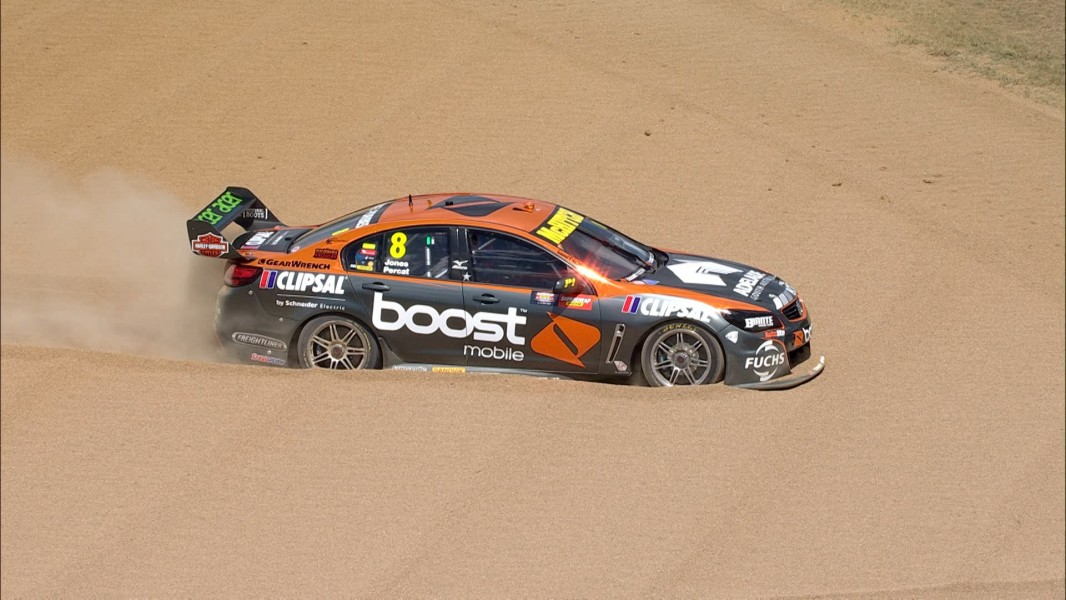 Walsh in the sand aboard BJR's #8 Holden