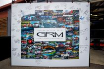 Drivers, fans sign GRM photo wall tribute