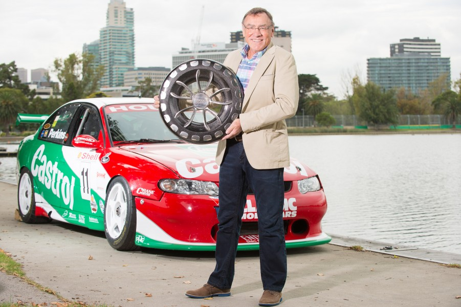 Former F1 and Supercars driver, Larry Perkins with the trophy