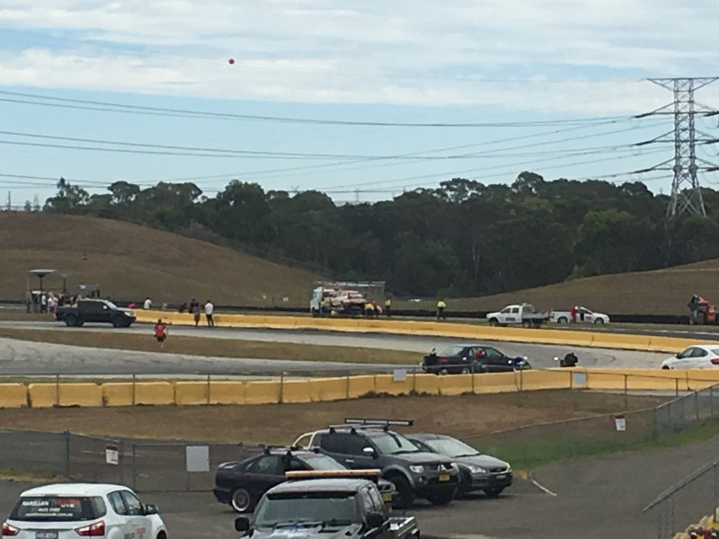 McLaughlin's car being recovered from Turn 1