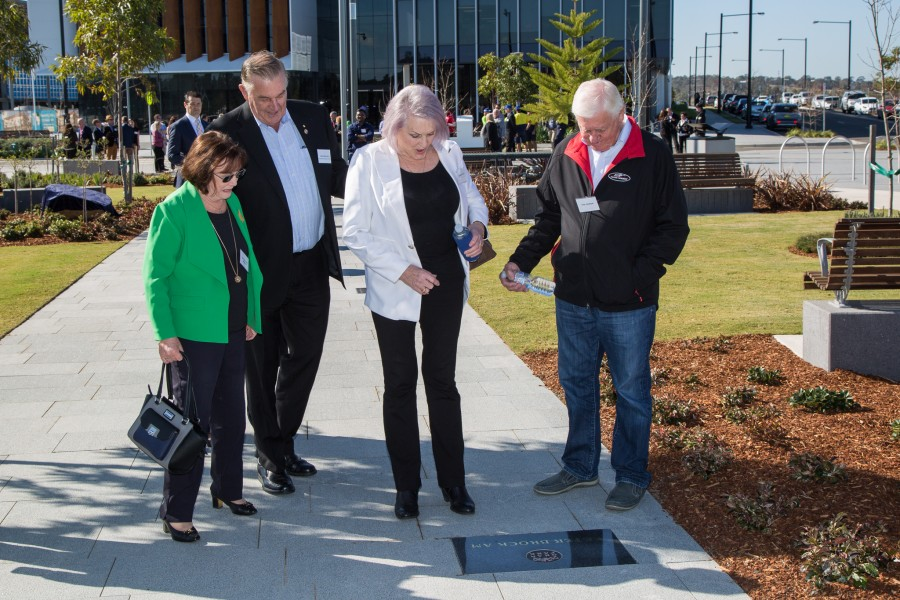 From left: Lady Margaret Brabham, Tony Perich, Beverley Brock and Dick Johnson inspect Peter Brock's plaque