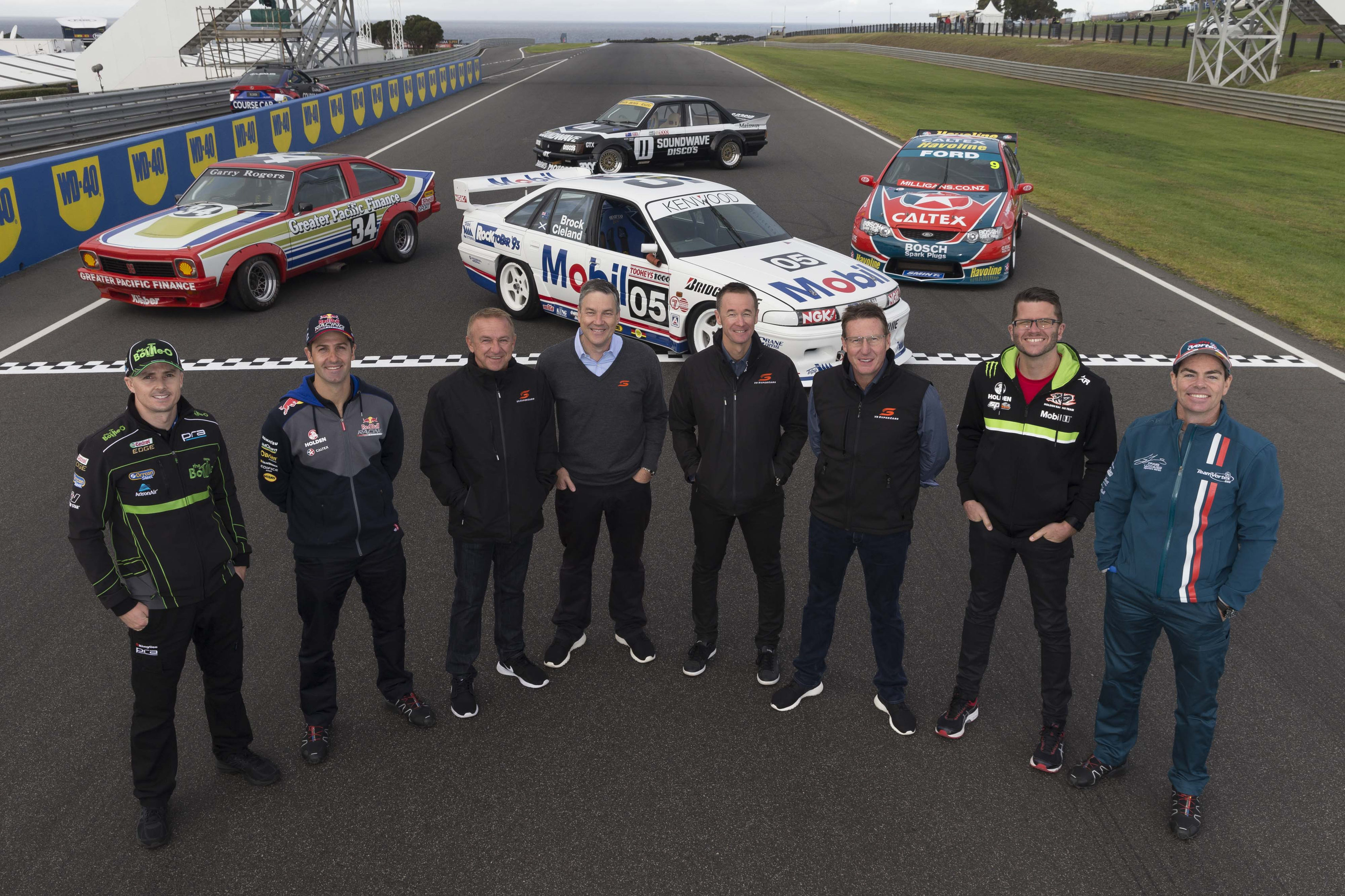 V8 Supercars drivers past and present gather on the grid to mark the 500th Championship Event during the WD-40 Phillip Island SuperSprint, in Phillip Island, Australia, April 16, 2016. drivers left to right. Mark Winterbottom, Jamie Whincup, Russell Ingall, Neil Crompton, Greg Murphy, Mark Skaife, Garth Tander and Craig Lowndes