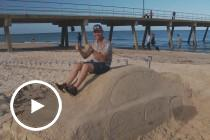Craig Lowndes hits the beach at Glenelg