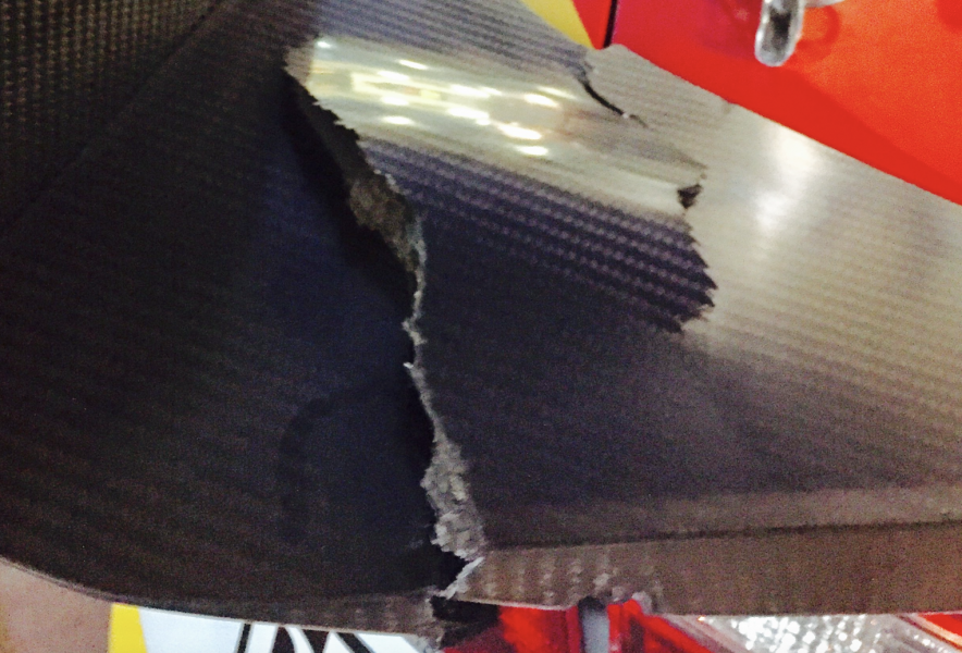The damage to Coulthard's wing mount